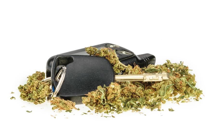 Driving high marijuana and car key isolated on white