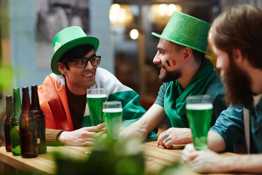 Guys drinking beer and talking on St Patrick day