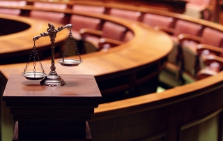 Los Angeles criminal defense attorney - Symbol of law and justice in the empty courtroom law and justice concept.