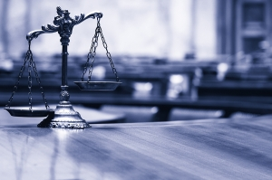 Los Angeles criminal defense attorney - Symbol of law and justice in the empty courtroom law and justice concept blue toned