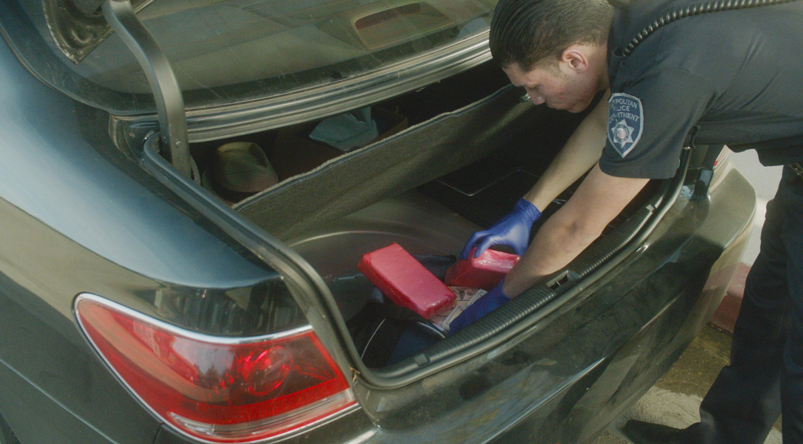 cop searching through car